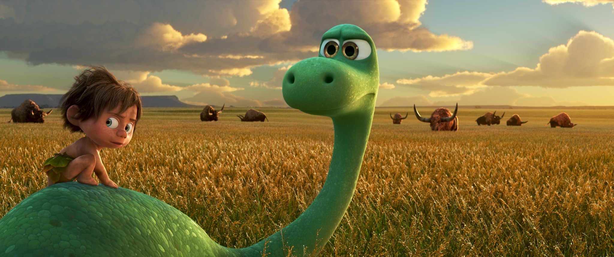 "AN UNLIKELY PAIR — In Disney•Pixar's ""The Good Dinosaur"" Arlo, an Apatosaurus, encounters a human named Spot. Together, they brave an epic journey through a harsh and mysterious landscape. Directed by Peter Sohn, ""The Good Dinosaur"" opens in theaters nationwide Nov. 25, 2015. ©2015 Disney•Pixar. All Rights Reserved."